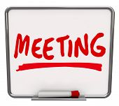 The word Meeting written on a dry erase board with a red marker, promoting a presentation, meetup, d