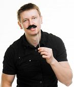 Young man with fake mustache. picture over light background isolated on a white background