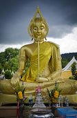 PHUKET, THAILAND - MAY 11: Golden Buddha Statue in the city cemetery on May 11, 2013 in Phuket, Thai