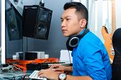 stock photo of mixer  - Asian Indonesian musician - JPG