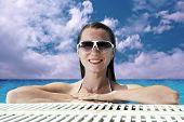 Beautiful happiness girl in white bikini stay in the waterpool