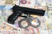 stock photo of shekel  - Currency from world with handcuffs and handgun - JPG