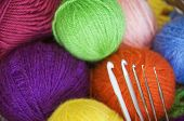 stock photo of hook  - Wool colored yarns and some crochet hooks - JPG