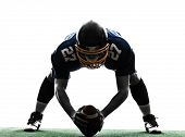 stock photo of studio  - one center  american football player man in silhouette studio isolated on white background - JPG