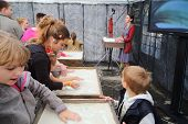 MOSCOW - AUGUST 18: Children participate master-class of sand animation from creative center 7bioz a
