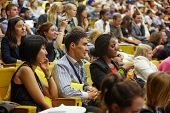 MOSCOW - AUG 20: Multinational youth audience of  Global Youth to Business Forum in congress-hall of