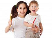 Girl teaches boy brushing the teeth