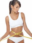 stock photo of fitness-girl  - Young beautiful woman with measure tape on white - JPG