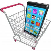 A new smart phone or cellphone in a shopping cart to illustrate buying a new mobile telephone