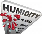 stock photo of humidity  - The rising humidity rate level rising on a thermometer past 100 percent to tell you of danger or uncomfortable weather conditions in the hot summer heat - JPG