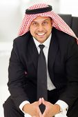 cheerful arab businessman sitting in office