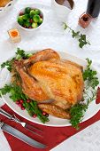 stock photo of horn plenty  - Garnished roasted turkey on fall festival decorated table with horn of plenty and red wine