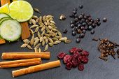 foto of cardamom  - cloves cardamom cinnamon juniper berries and dried cranberries Gin tonic spices with lemon and cucumber - JPG