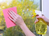foto of trigger sprayer bottle  - Hands with spray cleaning the window - JPG