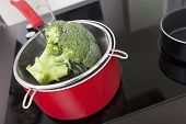 Broccoli in saucepan on stove at kitchen