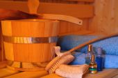 foto of transpiration  - Close up photo from sauna equipment such as towel oil brush and bucket - JPG