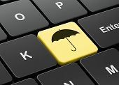 Security concept: Umbrella on computer keyboard background