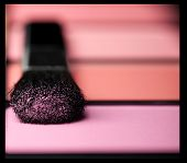 makeup brush and cosmetic powder close up