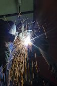 stock photo of pipe-welding  - Welder with protective mask doing welding metal pipe - JPG