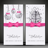 Website banner set design for Happy Holidays with floral decorative hanging Xmas balls, gift boxes and pink ribbon.