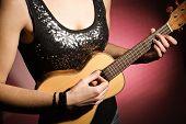 Woman playing the ukulele
