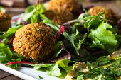 stock photo of chickpea  - Middle East cuisine: a plate of delicious falafels and hummus. Vegetarian fare.