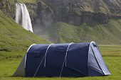Iceland. South Area. Eyjafjalajokul Zone. Seljalandsfoss Waterfall And Camping Tent.