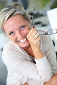 foto of stressless  - Portrait of smiling mature woman with eyeglasses - JPG