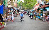 HO CHI MINH CITY, VIETNAM-  NOV 17, 2013: Crowded marketplace with street vendor in Ho Chi Minh City