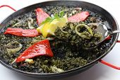 squid ink paella, spanish dish