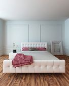 White leather upholstered bedroom suite in a modern white bedroom interior with a wooden parquet flo