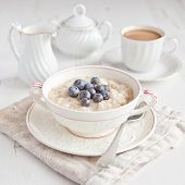 Healthy Breakfast: Oats Porridge With Coffee On The Table