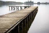 stock photo of dock a lake  - wooden dock extending into a blue lake - JPG