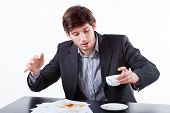 Young Businessman Spills Coffee For Documents