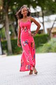 foto of jamaican  - Stock image of a young Jamaican model posing in a pink summer dress - JPG