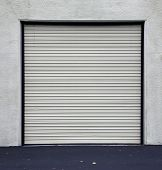 A Genuine Aluminum Warehouse Garage Roll Up Door and Entrance Door. Many Warehouses and Office Build