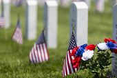 stock photo of deceased  - veterans cemetery memorial celebration with American Flag - JPG