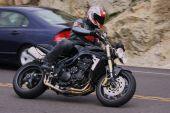foto of crotch-rocket  - Speeding  motorcycle on a country road passing cars - JPG