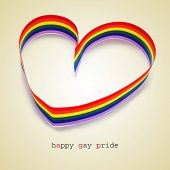 a rainbow ribbon forming a heart and the sentence happy gay pride