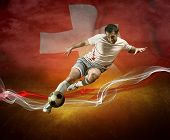 Abstract waves aroun soccer player on the national flag of Switzerland