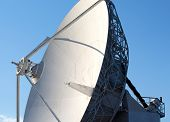White Radio Telescope Against A Blue Sky