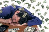man slepping with dollar bills
