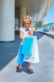 Shopaholic little girl with shopping bags