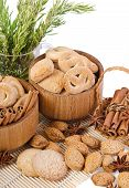 Sweet Sugar Cookies In Wooden Containers With Cinnamon Sticks, Almonds, Anise Asterisks, And A Pitch