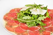image of veal  - Veal carpaccio with rucola parsley and cheese - JPG