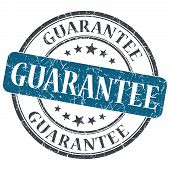 Guarantee Blue Round Grungy Stamp Isolated On White Background