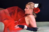 stock photo of harlot  - Beautiful blonde laying on chaise lounge - JPG