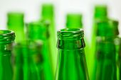 Ten Green Bottle Necks, One Bottle In Focus On Foreground.