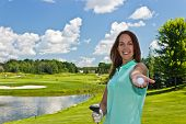 picture of ladies golf  - Woman with golf ball and club on the fairway - JPG