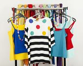 foto of wardrobe  - Wardrobe with colorful summer clothes and accessories - JPG